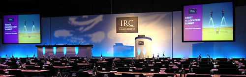 IRC Financial Seminar in London, with two side Screens and Gobo lighting effects across the centre of the set